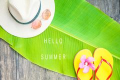 Palm leaf Straw hat Pink sunglasses Beach flip-flops Summer background. Copy space Top view royalty free stock image