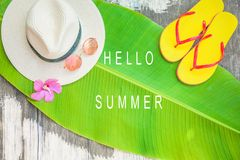 Palm leaf Straw hat Pink sunglasses Beach flip-flops Summer background. Top view stock photography