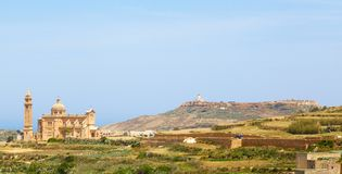 Palm leaves and Ta 'Pinu Church. In village Gharb, Gozo island, Malta Royalty Free Stock Images