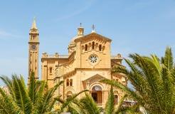 Palm leaves and Ta 'Pinu Church. In village Gharb, Gozo island, Malta Stock Photos