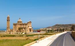 Palm leaves and Ta 'Pinu Church. In village Gharb, Gozo island, Malta Royalty Free Stock Image