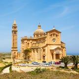 Palm leaves and Ta 'Pinu Church. In village Gharb, Gozo island, Malta Royalty Free Stock Photos