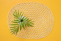 Palm leaves in a vase on a decorative yellow background stock photos