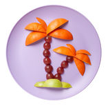 Palm made of apple, grape and orange Royalty Free Stock Photography