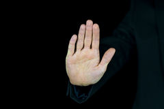 Palm of a male hand on a black background Royalty Free Stock Photography