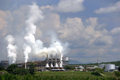 Palm Oil Factory. Image of a palm oil factory with an oil palm estate in the foreground at Johore, Malaysia Stock Images