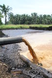 Palm Oil Mill Effluent (POME) wastewater being discharged - Series 5 Royalty Free Stock Photography