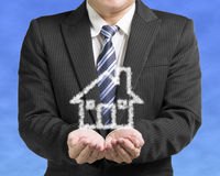 Palm opening business man with cloud shape house in blue sky bac. Kground Royalty Free Stock Photo