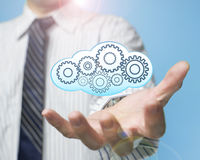 Palm opening businessman with cloud fill with gears Stock Photos