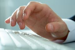 Palm over keyboard Royalty Free Stock Photos