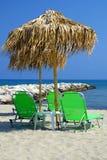 Palm parasol at summer beach Stock Photos