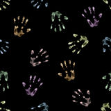 Palm print drawn in chalk. Seamless hand drawn pattern of palm imprints drawn in color chalk isolated on black background Royalty Free Stock Photography