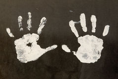 Palm Prints. A child's palm prints on black construction paper. Image has lots of rough textures Royalty Free Stock Images