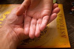Palm reading. Foretelling the future through the study of the palm and astrology stock images