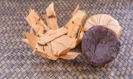 Palm Sap Sugar IX. Palm sap sugar on a wicker background royalty free stock photo