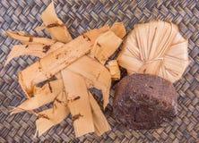 Palm Sap Sugar XI. Palm sap sugar on a wicker background royalty free stock photos