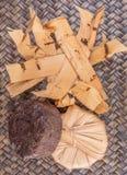 Palm Sap Sugar XII. Palm sap sugar on a wicker background royalty free stock photography