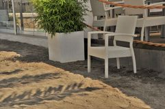 Palm shadow on a beach bads stock photography