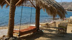 Palm shed at Red Sea, Egipt. Palm shed and hammock Royalty Free Stock Photos