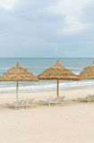 Palm shelter and sunbeds on China Beach in Da Nang Royalty Free Stock Images