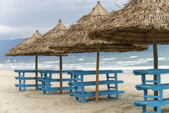 Palm shelters in China Beach in Da Nang Stock Images