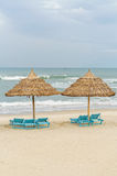 Palm shelters and sun beds in China Beach in Da Nang Royalty Free Stock Photos