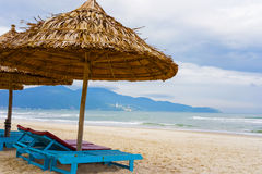 Palm shelters and sunbeds at China Beach in Da Nang Royalty Free Stock Photos