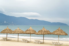 Palm shelters with sunbeds in China Beach in Da Nang Royalty Free Stock Photos
