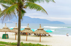 Palm shelters and tourists at China Beach in Da Nang Stock Photography