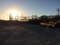 Palm Springs, CA. Power Plant log fence desert sunrise sunset stock photo