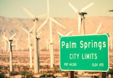 Palm Springs City Limits. Highway Sign and Wind Turbines in the Background. Palm Springs, California, USA stock image