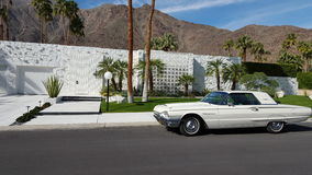 Palm Springs House with Thunderbird. In front--all white stock photos