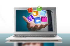 Palm stretch out laptop screen with app blocks Royalty Free Stock Photography
