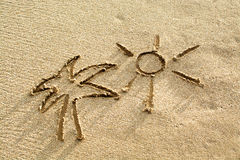 Palm and sun drawing on the beach sand Royalty Free Stock Photo