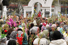 Palm Sunday celebrations in the Orthodox Church. April 24, 2016, Minsk, Belarus. The priest at the center of the crowd sprinkling holy water willow twigs with Royalty Free Stock Photography