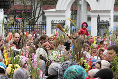 Palm Sunday celebrations in the Orthodox Church. April 24, 2016, Minsk, Belarus. The priest at the center of the crowd sprinkling holy water willow twigs with Royalty Free Stock Image