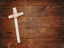 Palm Sunday cross on wooden board. Christian festival. Palm cross as distributed by Sunday Schools etc stock photo