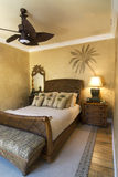 Palm Tree bedroom. Bedroom decorated in tropical style with ceiling fan Stock Image