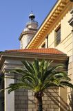 Palm tree and church at Nice in France Stock Photos