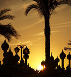 Palm-tree and cupola silhouette stock photos