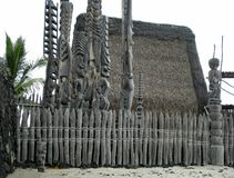 Palm Tree, Grass Hut, Picket Fence, Escape Platform, and Tall Wooden Tikis Guarding the Place of Refuge stock image