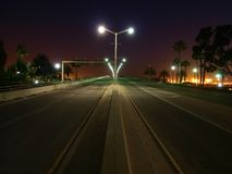 Palm Tree Highway Night. Palm trees line an open California highway at night Royalty Free Stock Photo