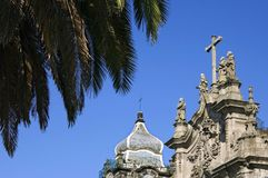 Palm tree and historic church Carmo in Porto. Portugal, region Costa Verde or Green Coast, city Porto or Oporto. The top gable of the historic church, Igreja Royalty Free Stock Photo