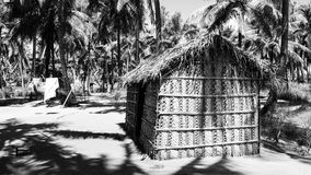 Palm tree house. Black and white in Mozambique, Africa Royalty Free Stock Photography