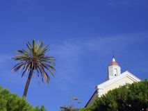 Palm tree and Italian church Royalty Free Stock Photos