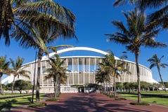 Palm Tree Lined Walkway Leading Towards Moses Mabhida Stadium. DURBAN, SOUTH AFRICA - FEBRUARY 23, 2018: Close up morning empty palm tree lined paved walkway Royalty Free Stock Photography