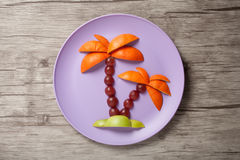 Palm tree made of fruits Stock Photos