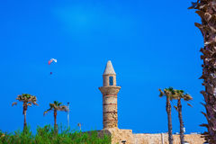 Palm tree, minaret and  parachute Stock Image