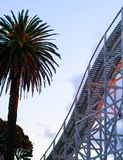 Palm Tree and Roller Coaster During Sunset royalty free stock photos