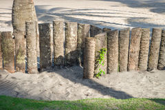 Palm tree trunk wood fence in the beach. Palm tree trunk wood fence in rainforest beach in Brazil Stock Photography